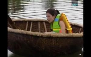 flo paddling a boat