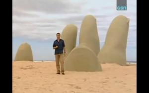 phil hand in sand